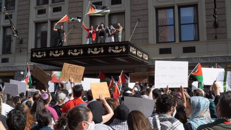 Palestinian protestors in Boston stand outside the Israeli Consulate General.