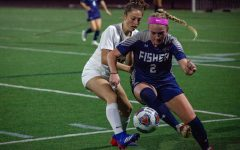 Freshman midfielder Chelsea Fallon fights for possession with Fisher defender.