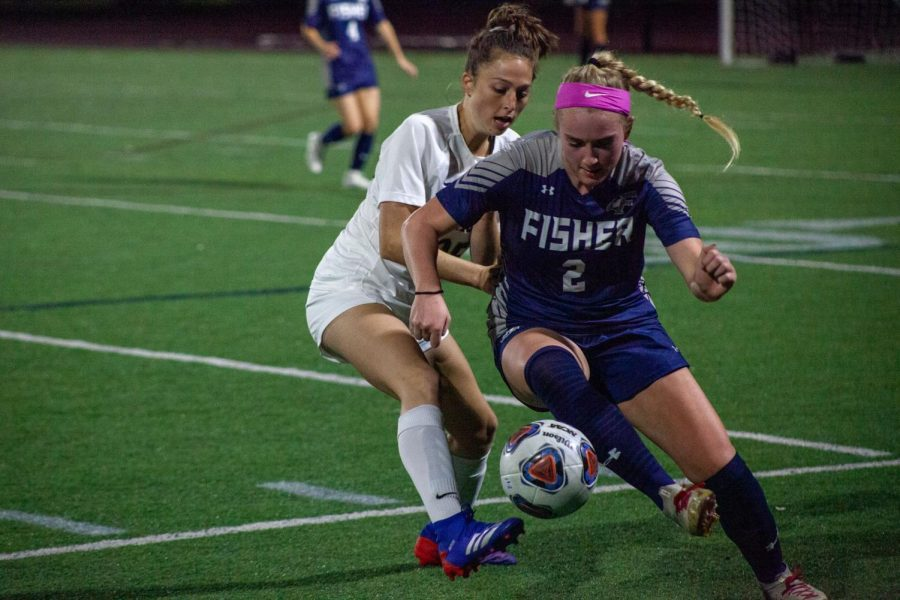 Freshman+midfielder+Chelsea+Fallon+fights+for+possession+with+Fisher+defender.
