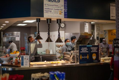 Workers prepare food at the Smith Cafe