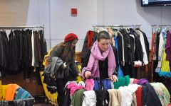 Two girls shop at a past thrift sale for the Performing Arts Office. The annual sale returns for the first time since the pandemic on Oct. 19 and 20.