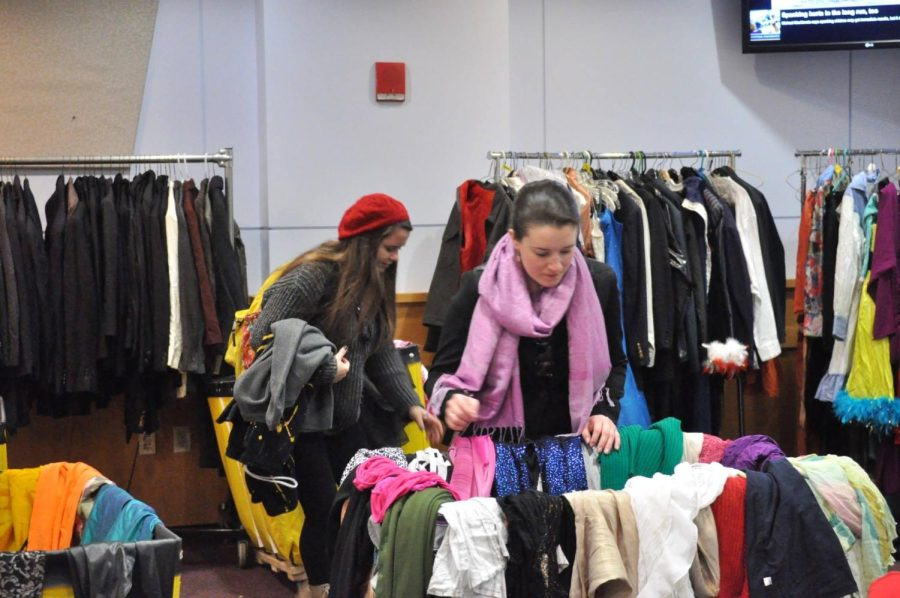 Two+girls+shop+at+a+past+thrift+sale+for+the+Performing+Arts+Office.+The+annual+sale+returns+for+the+first+time+since+the+pandemic+on+Oct.+19+and+20.